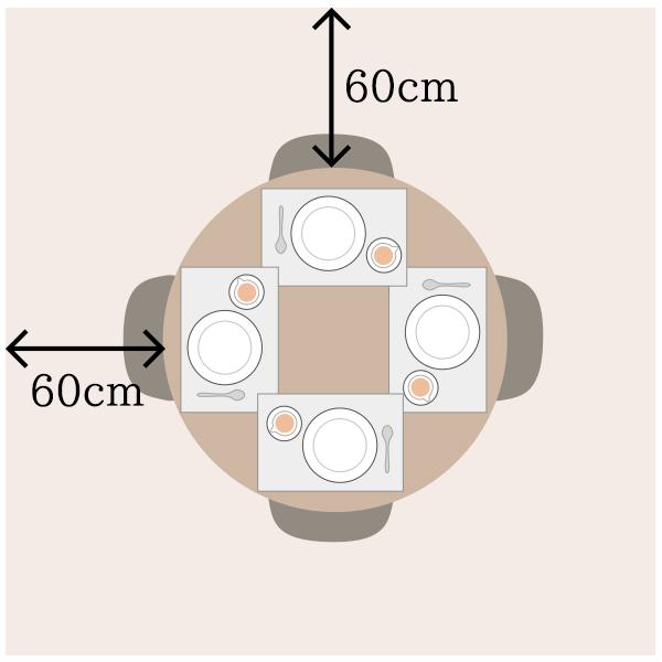 丸い天板のダイニングテーブルを上から見るとランチョンマットが重なる部分がある